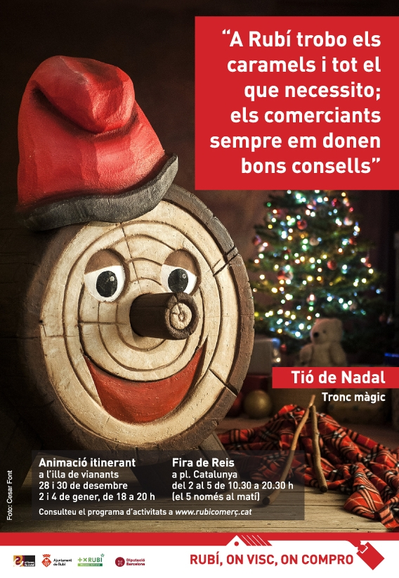 The Catalan Christmas log promoting local shopping. El tió de Navidad promociona el comercio local. El tió promociona el comerç local per Nadal.